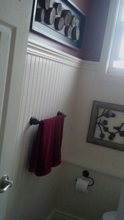 """Small red bathroom, beadboard to 63"""" with details added. Used Benjamin Moore garrison red."""