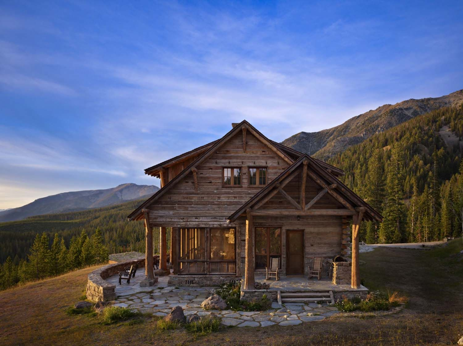 Rustic mountain retreat offers sweeping views over big sky for Log home architects