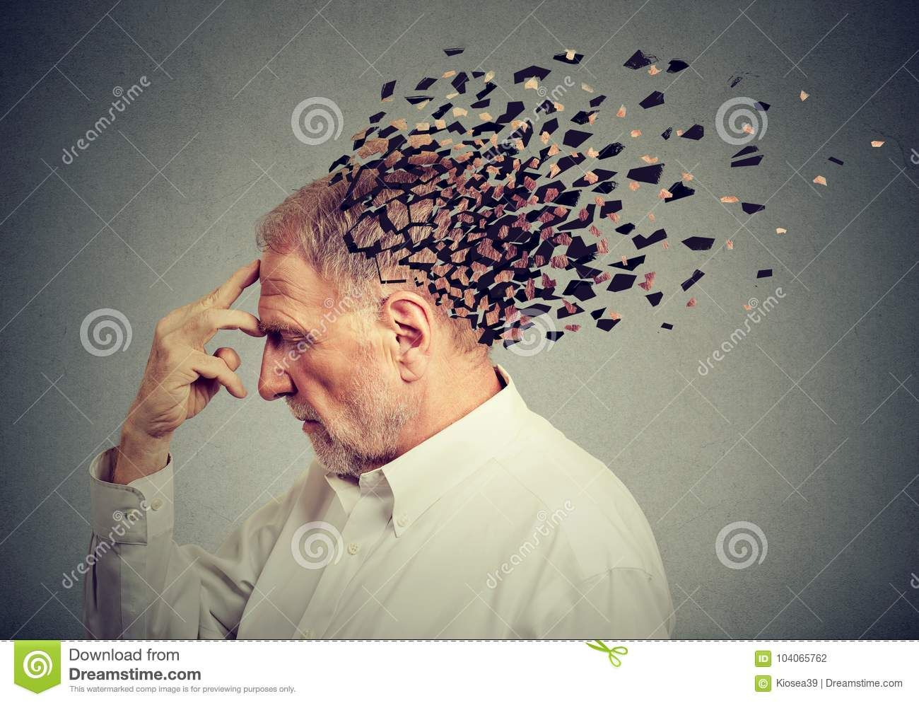 Memory loss due to dementia. Senior man losing parts of ...