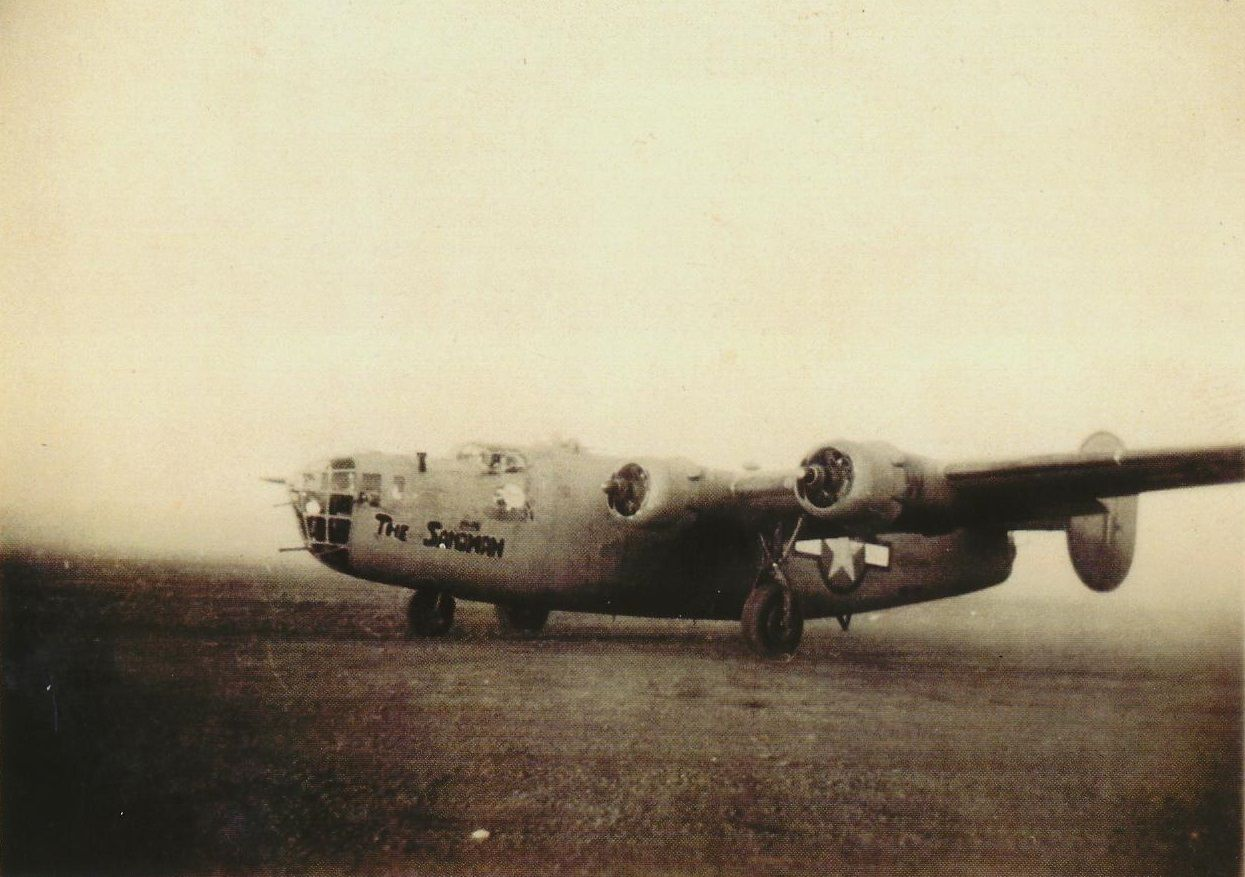 """Consolidated B-24D-55-CO Liberator 42-40402, """"The Sandman,"""" takes off for Ploesti, 1 August 1943. (U.S. Air Force)"""