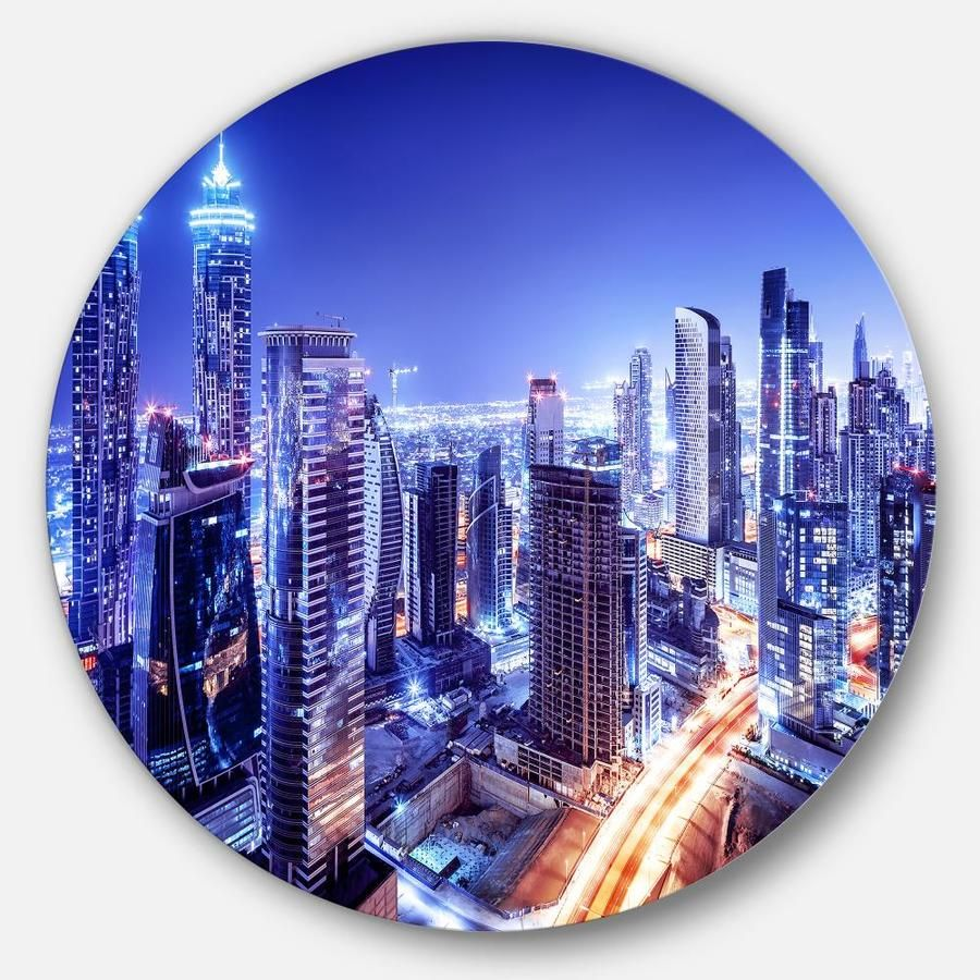 Easy to clean with a microfiber cloth. 1-inch mounting frame gives the illusion of artwork floating on the wall. Mounting brackets and instructions are included. High quality digital images are created directly into a glossy aluminum panel, producing a stunning and captivating print in the glossy finish of the metal. Designart Dubai Downtown Night Scene' Cityscape Photography Circle Metal Wall Art in Blue | MT6470-C11