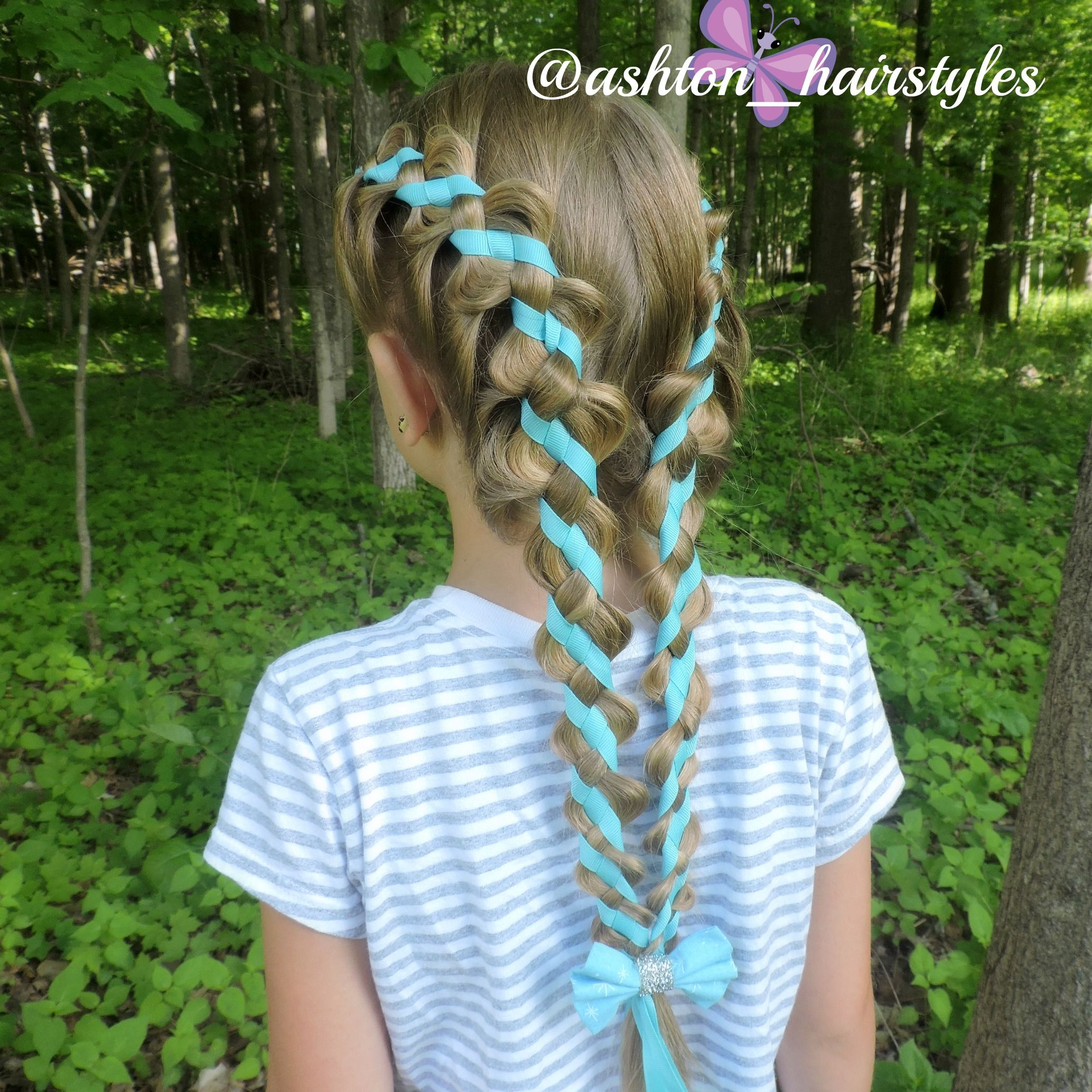 4 strand woven pigtails finished off with a cute Elsa bow by