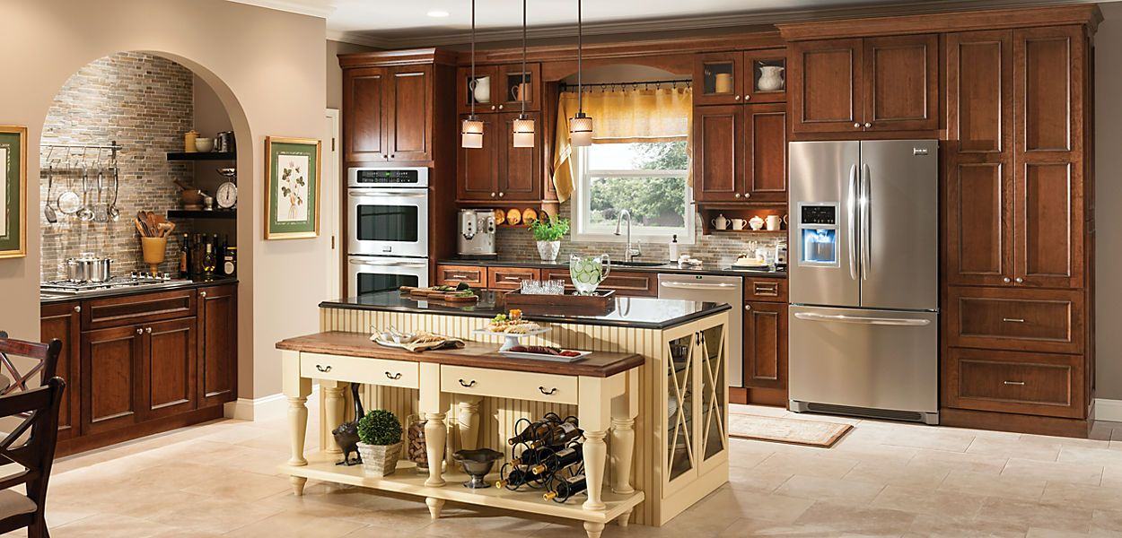 room gallery schuler cabinetry cherry amaretto glaze island shown in maple