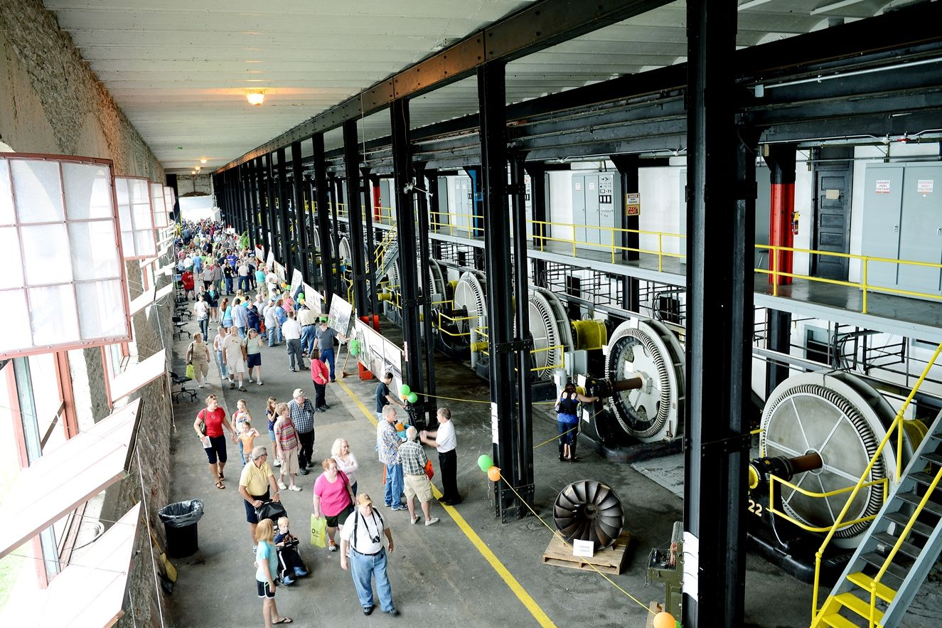 A crowd enjoying the inside of the Cloverland Electric Cooperative Hyrdoelectric Plant in Sault Ste. Marie, MI.