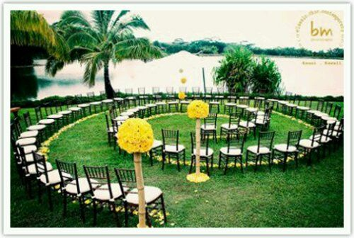 Love the idea of having the guests seated in a circle. When you walk up the aisle after the ceremony you have a chance to pass by and greet each guest!