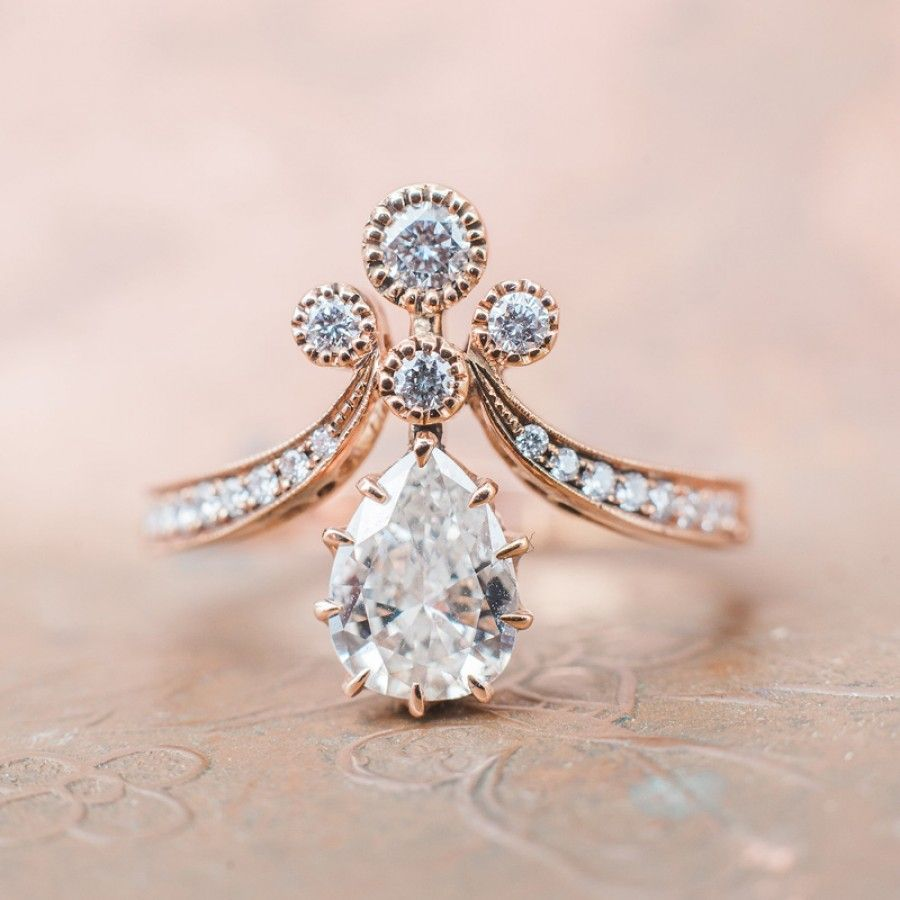 victorian wedding rings Vintage inspired rose gold Tiara engagement ring with a pear shaped diamond photography by Whiskers Willow