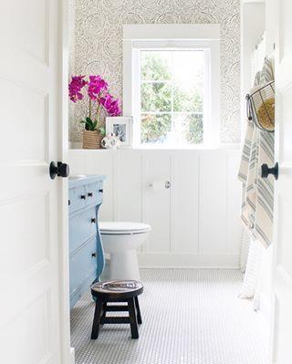 Blue vanity in bathroom.