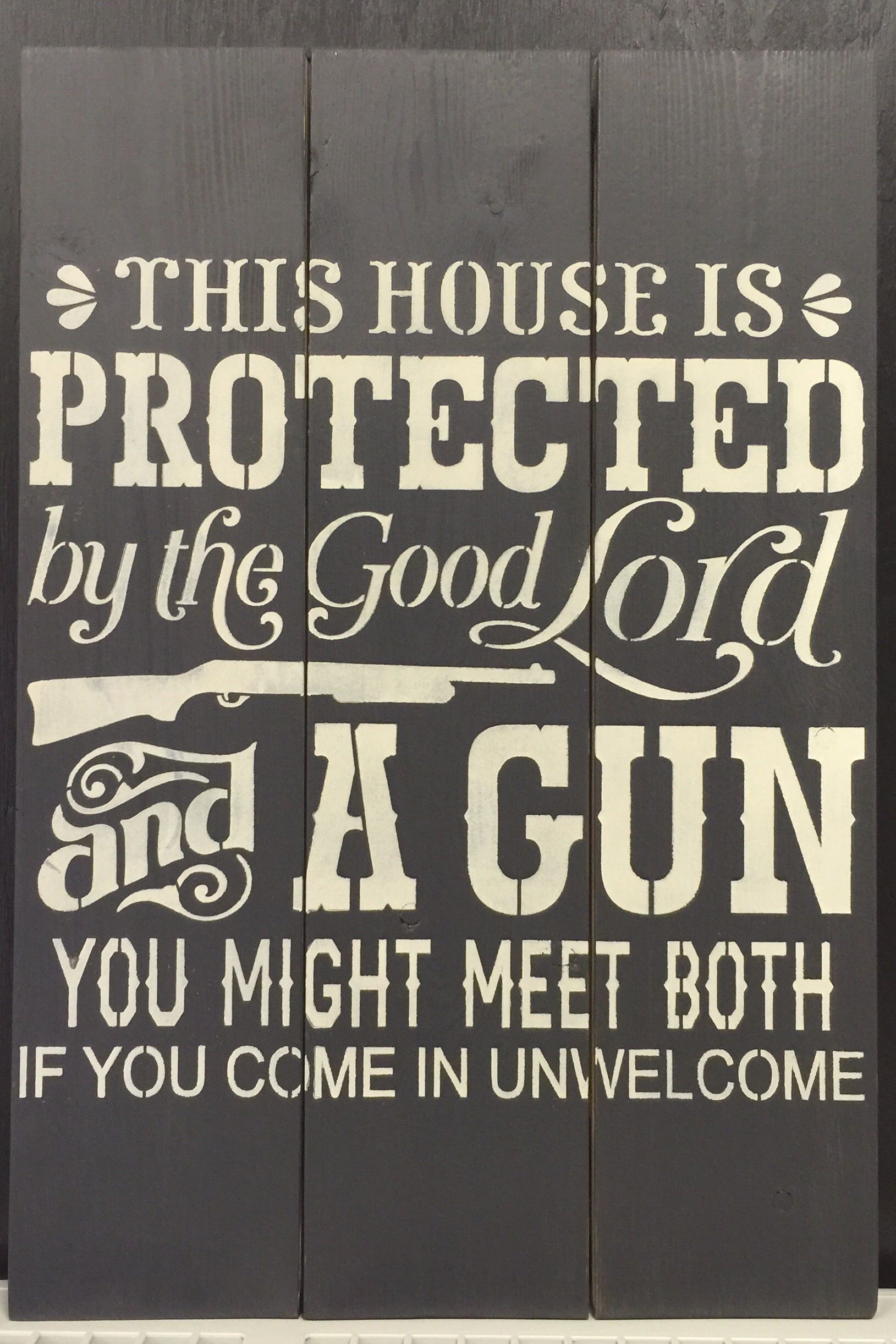 Indoor planked wooden pine sign this house is protected