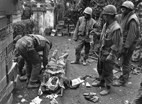 19 February 1968: A wounded American soldier being attended to during the Vietnam war. (Photo by Terry Fincher/Express/Getty Images)