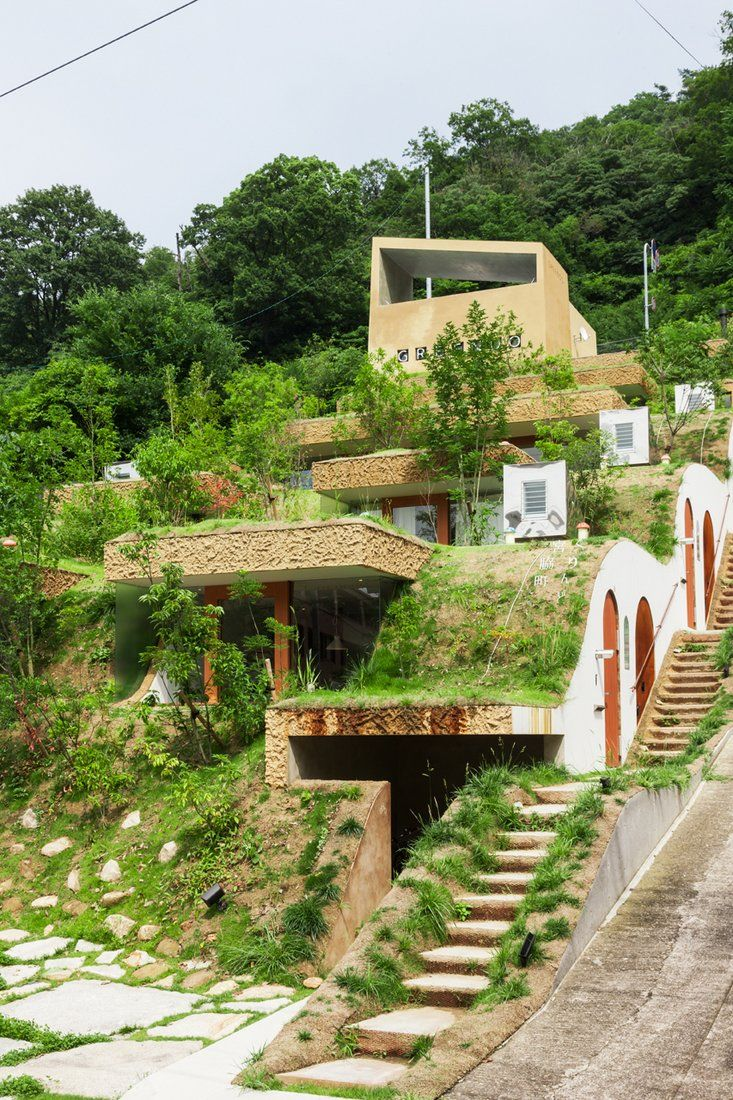 Greendo undulating geothermal homes built into the side for Undulating architecture