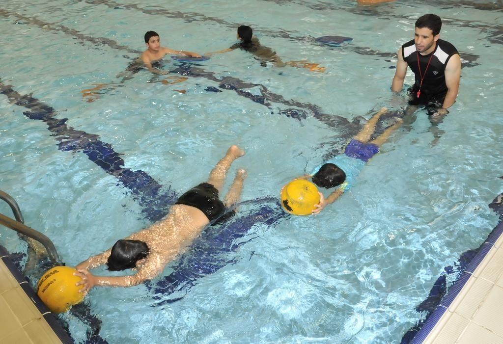 جانب من تدريبات أطفال برنامج صيفي في نشاط السباحة بإشراف مدربين متخصصين مراكز الأطفال الشارقة Outdoor Outdoor Decor Hot Tub