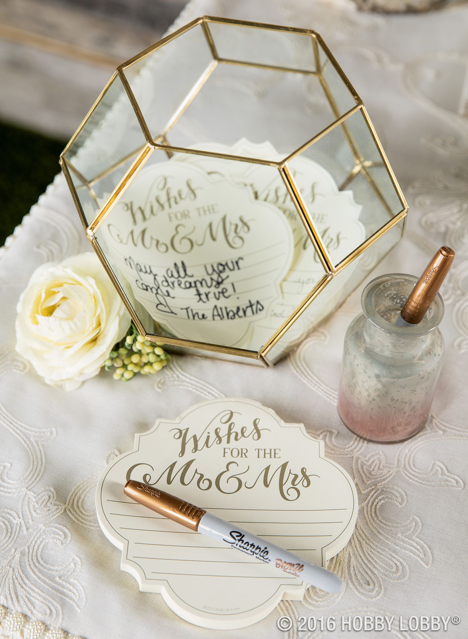 use a terrarium to add instant style to your guest book table