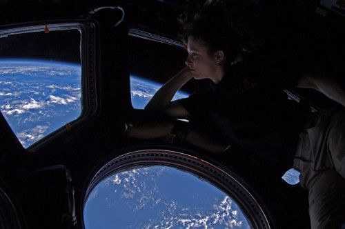 Astronaut Tracy Dyson looking out the observation window on the International Space Station...