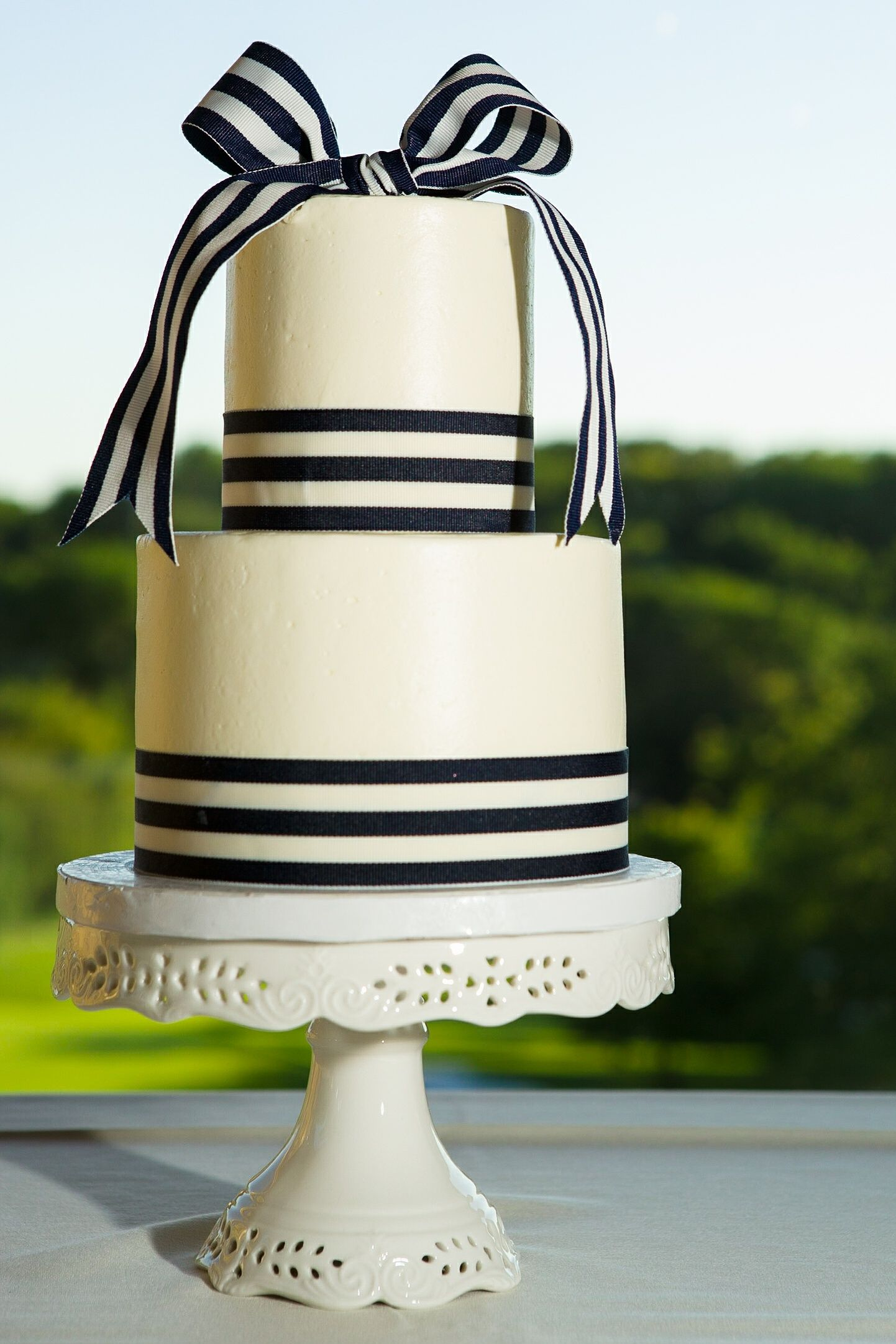 navy and white striped wedding cake; white cake pedestal  overlooking the golf course at Alvamar Country Club in Lawrence, KS Photo: Chris Bendet Photography