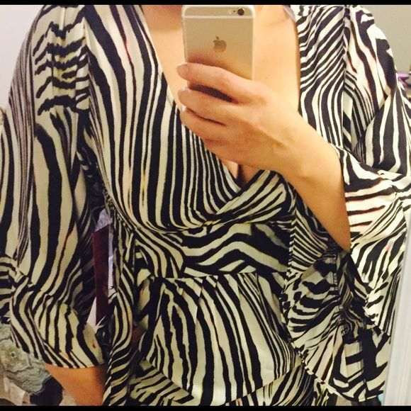 Betsy Johnson zebra blouse Beautiful zebra Betsy Johnson, blouse, I love it however it does not fit me in the chest area, fits more an A or B cup maybe a C. Betsey Johnson Tops Blouses