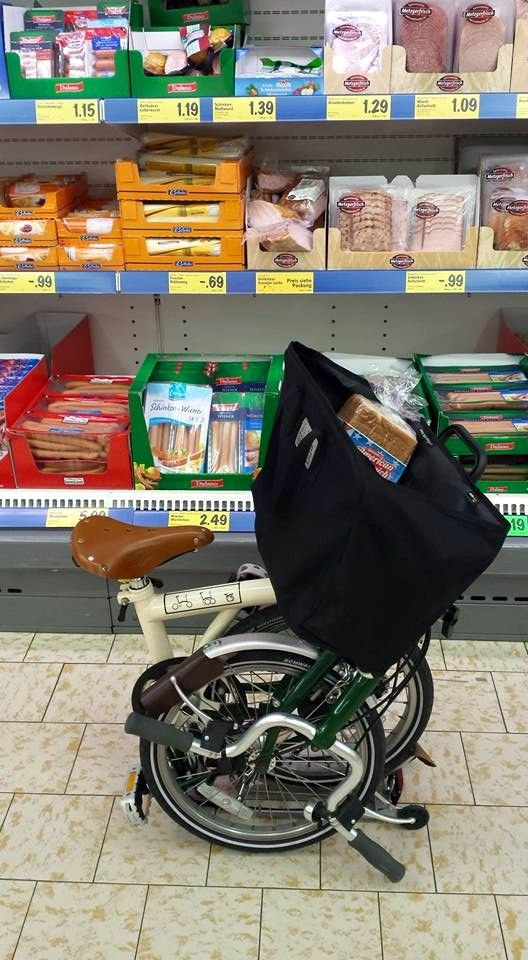 Anita Rowley - Shopping in Germany with an old ivory and British racing green T5. Brompton