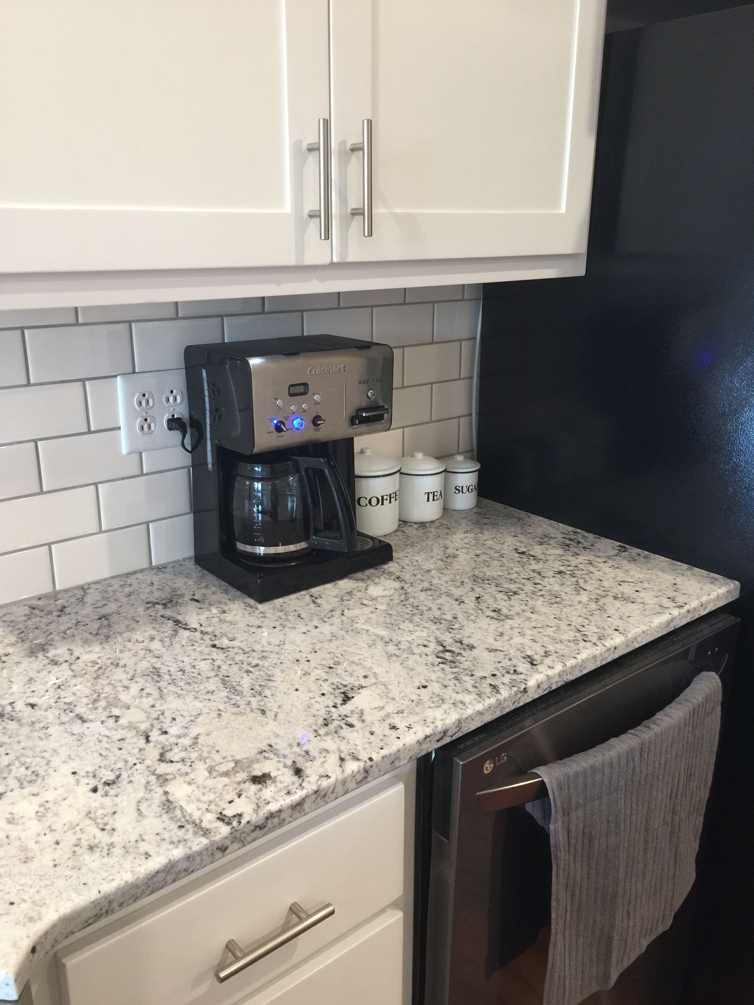 White Ice granite, white subway tile with gray grout ...