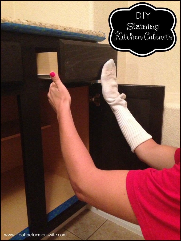 {DIY Staining Kitchen Cabinets} A complete makeover staining kitchen  cabinets from oak to a rich dark espresso color. Step