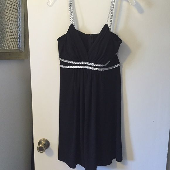 Black cocktail dress with silver accents Worn once, fun little black dress with silver rope-like accents Dresses