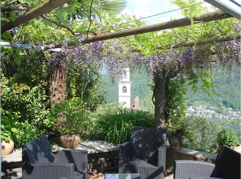 View at Ristorante La Sorgente, Vico Morcote (village beside Morcote), Ticino, Lake Ligano, Switzerland.