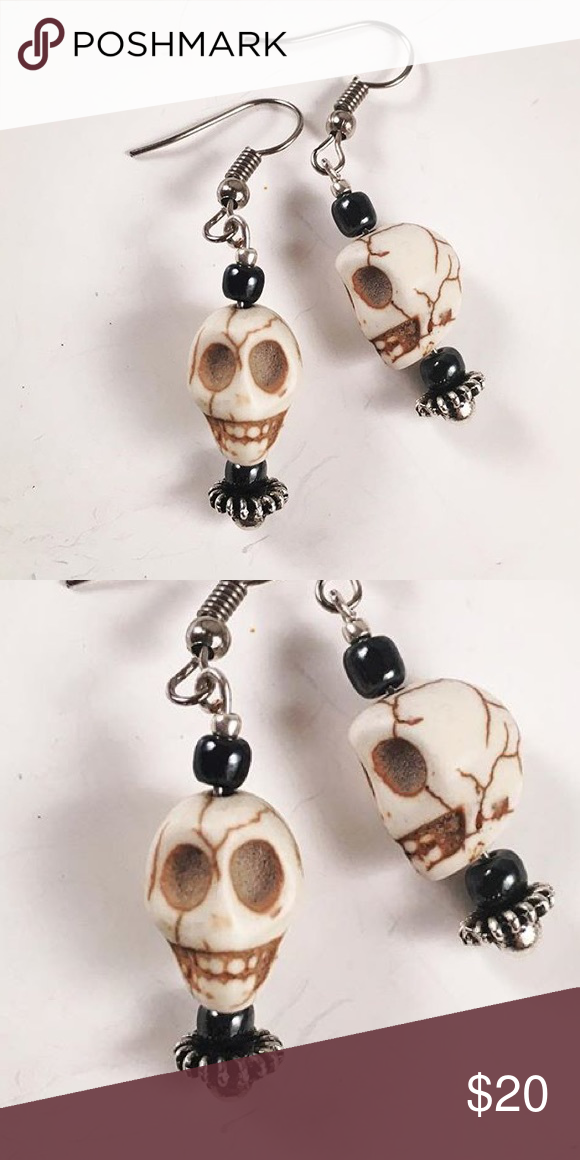 Women skull dangly earrings Women edgy / rock / goth / dangly skull earrings. Handmade by me , never worn by anyone. Hematite stones. white skull bone looking charms. Stainless steel post. I ship fast ✈️!! Jewelry Earrings