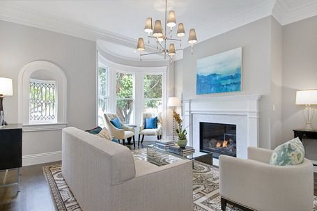 Abstract Blue Wall Art And Modern Fireplace In Traditional Living Room Design Ideas
