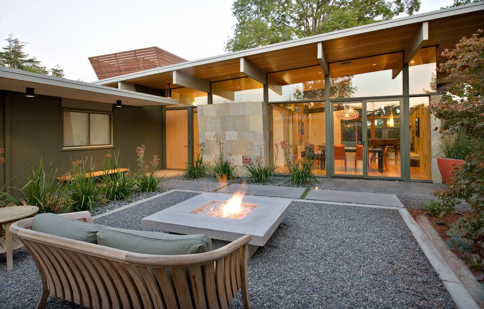 simple living room tv design patio midcentury with floor to ceiling windows bench seating pebble