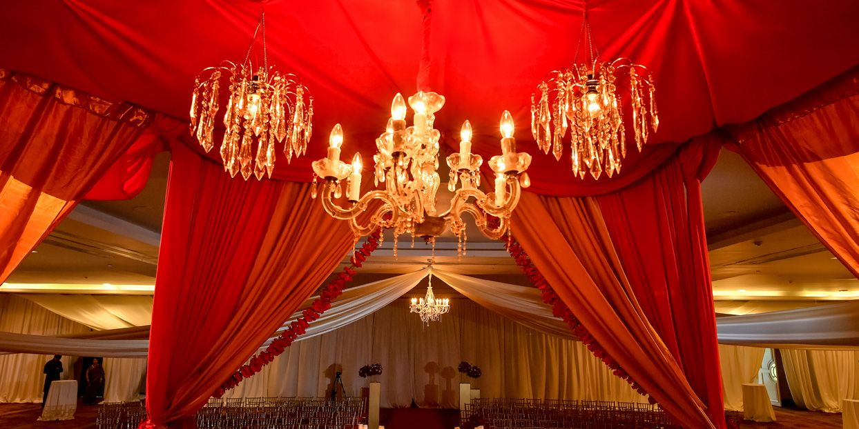 Sumptuous Chandeliers With Red And Gold Decoration For Reception
