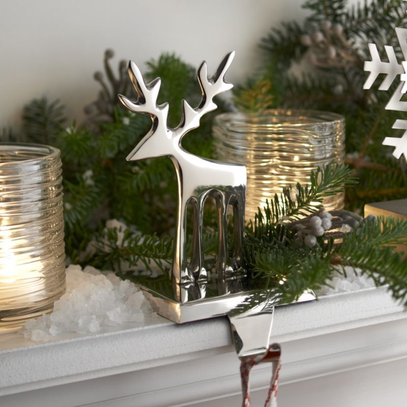 Streamlined reindeer glistens as contemporary stocking hook