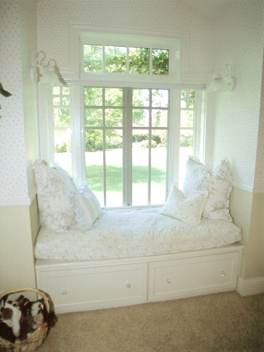 Monochromatic White Room With Bay Window Window Seat