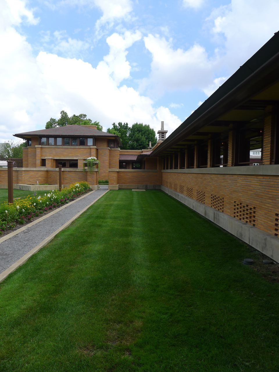 From the rear of Frank Lloyd Wright's Martin house, the pergola extends back to the conservatory (under the pagoda) and the carriage house on the left.