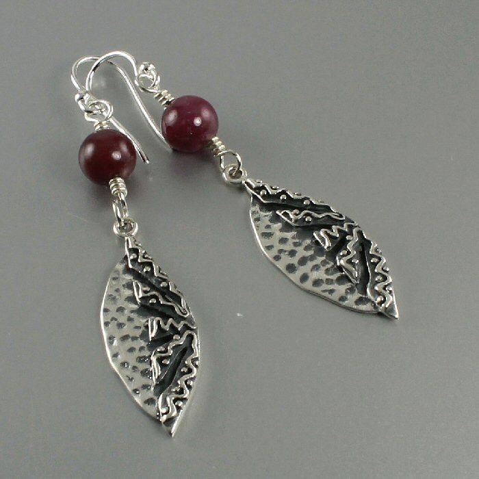 Natural ruby (not dyed or treated) sterling silver matoon leaf earrings. Ruby is the birthstone for July so these earrings would make a thoughtful gift. http://jewelrybytali.com/products/ruby-sterling-silver-leaf-earrings