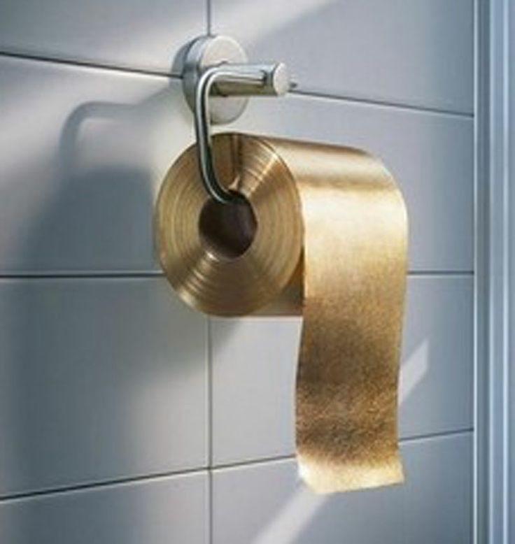 24k gold toilet paper. gold luxury is toilet paper. australian company paper man produced a roll made from flakes through the roll. 24k o