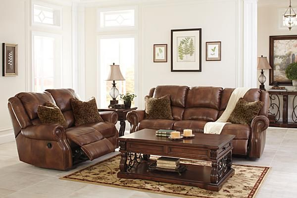 The Walworth Reclining Loveseat From Ashley Furniture HomeStore (AFHS.com).  Leather Match