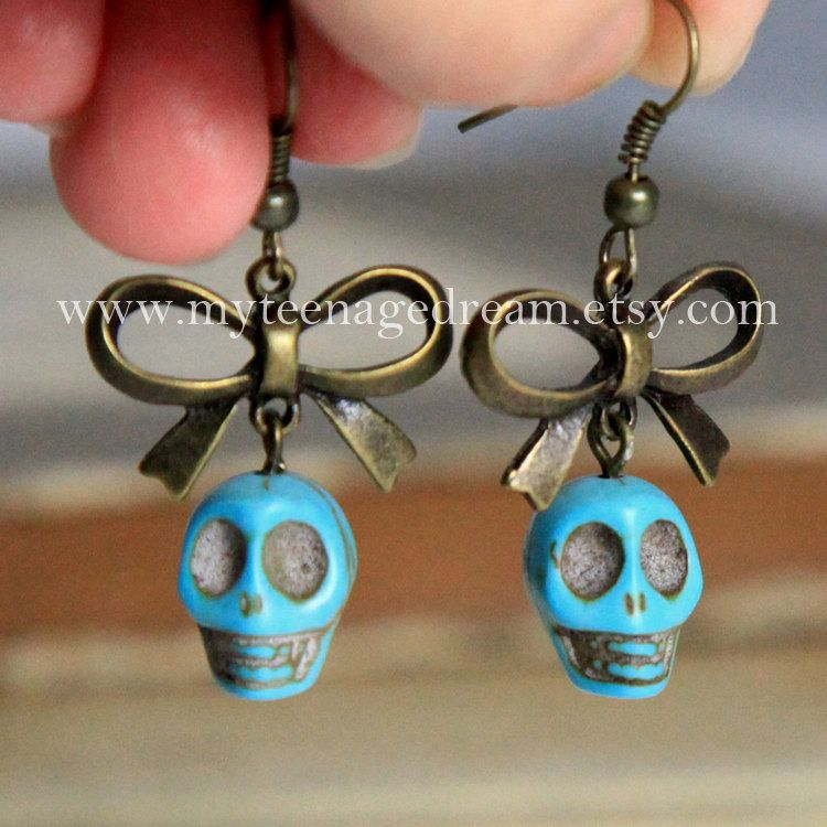 Antique bowknot  with blueTurquoise skull earrings, Day of the death. $4.50, via Etsy.