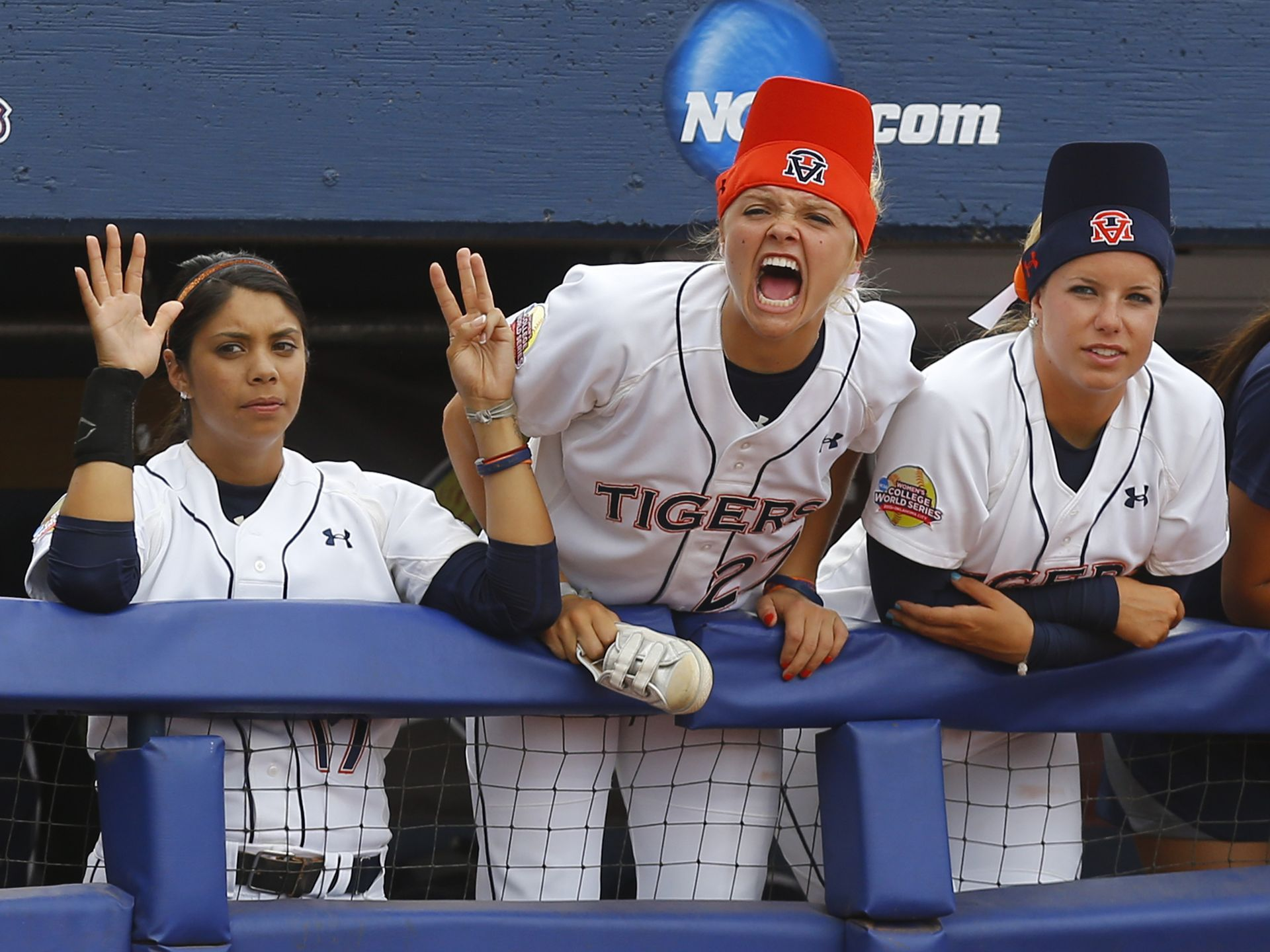 Auburn s victoria draper center shouts from the dugout in the seventh inning of a game against lsu in the ncaa women s college world series softball