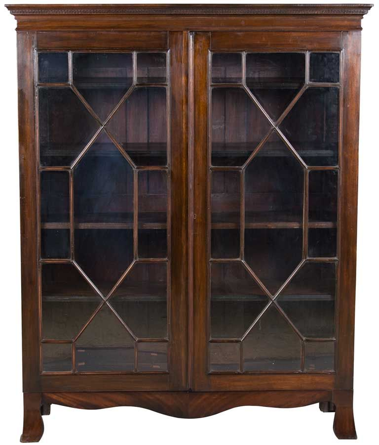 This antique bookcase was made in Victorian England c1900. It features  flame mahogany, glass doors, and adjustable bookshelves. - Late Victorian Mahogany Antique Bookcase Furniture Pinterest