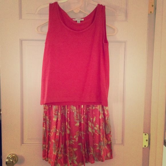 St John Top and Pleated Skirt Very classy St John Knit watermelon colored top and pleated silk skirt. You will look so pulled together in this beautiful two piece set! The skirt zips on the side and is a size 6. The top is pullover sleeveless and a size P. St John Skirts