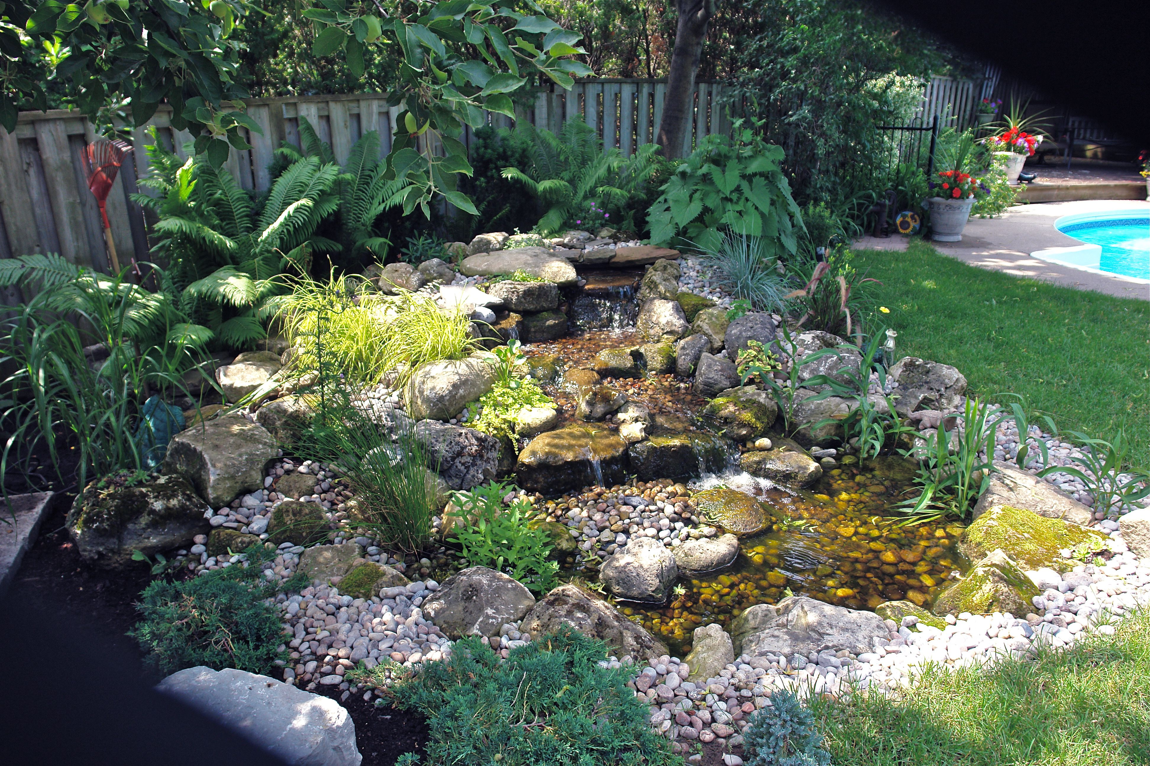 pondless waterfall and stream beside a pool | Fountains ...
