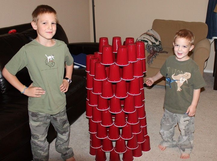 When we went to the science museum last weekend, they had one room devoted to building activities for older kids.  Their activities were simple and yet genius – I was amazed at what one can do with basic plastic cups!  We decided to try cup stacking at home. We got a large bag of 84 …