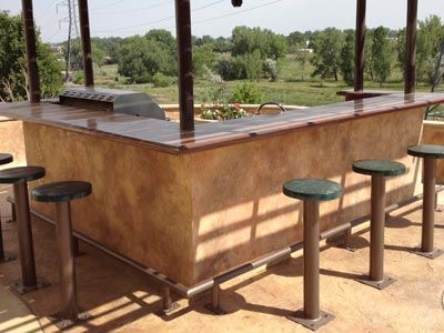 cool outdoor stained concrete countertop and bar stools | garden