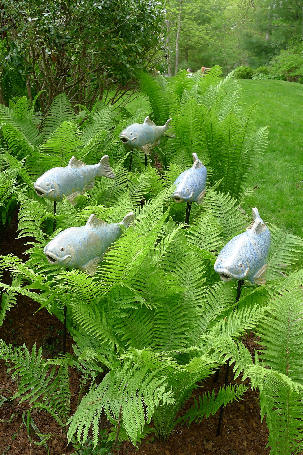 Unique garden art fish holographic and gardens for Fish garden statue