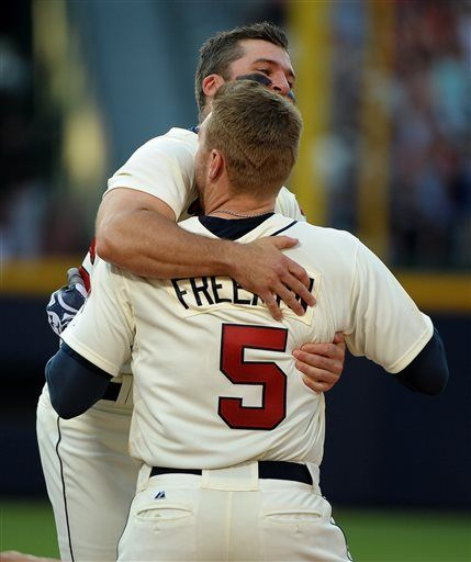 Atlanta Braves' Freddie Freeman is congratulated by teammate Dan Uggla after Freeman's bases loaded single scores the winning run during the ninth inning of their baseball game against the San Francisco Giants at Turner Field, Saturday, June 15, 2013, in Atlanta. The Braves won 6-5.