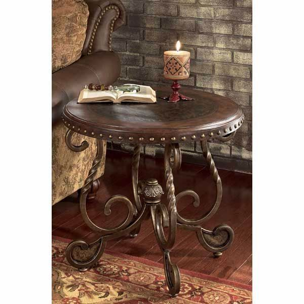 Rafferty Round End Table by Ashley Furniture Dark stained framed top with nailhead trim Etched metal accents on table top and leg Twist square detail on legs Hand applied finishes RTA construction #homedecor #decorideas