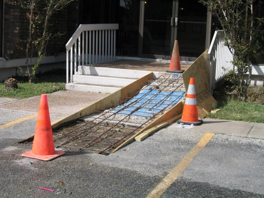 Concrete wheelchair ramp installation parking lot repair for Handicap stairs plans