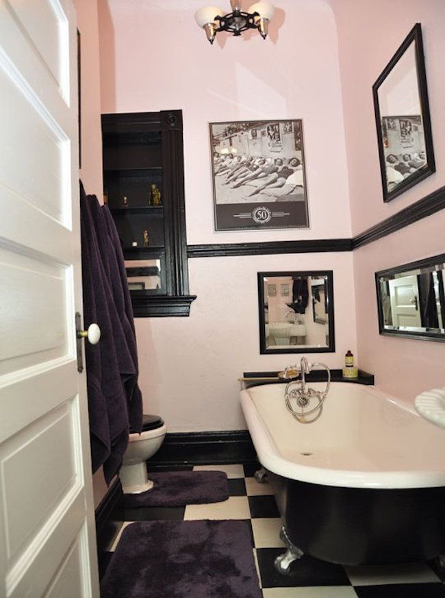 Light Pink And Black Bathrom With Retro Wall Art
