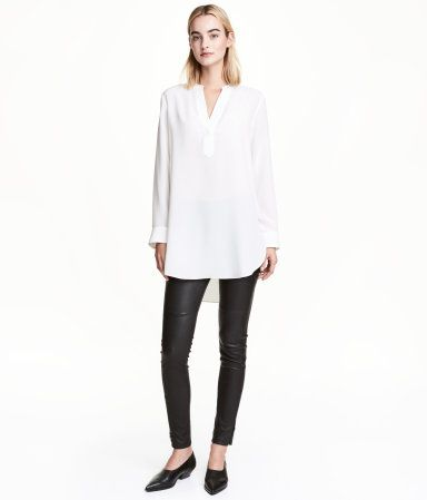 Black. PREMIUM QUALITY. Treggings with concealed elastication at waist and concealed zips at hems.