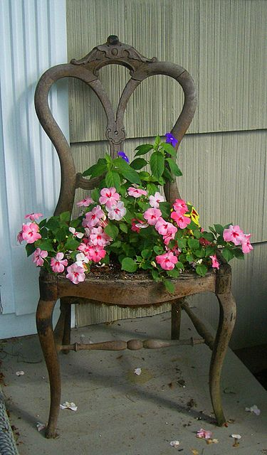 Chair Planter In Pink.. i have 2 red chairs like this. I have chicken wire in the bottom sometimes I used silk flowers. Like in early spring before anything ... & Chair Planter In Pink | DREAMS OF A GARDEN | Pinterest | Chair ...