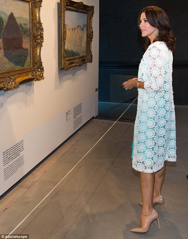 Stunning: The Australian-born royal showed off her summer tan and toned legs as she arrived at Denmark's Ordrupgaard Museum wearing a mint Prada dress and a pair of nude Prada heels