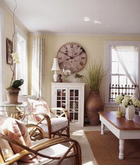 Cute cottage style living room, love the large clock and pot